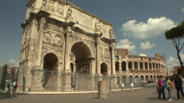 ws view of arch of constantine with colosseum in background / rome, italy - arch of constantine stock videos and b-roll footage