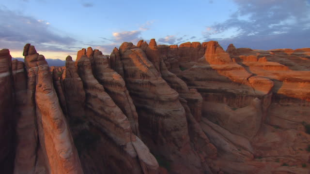 ms aerial view of arches in morning light at arches national park / utah, united states - arches national park stock videos & royalty-free footage