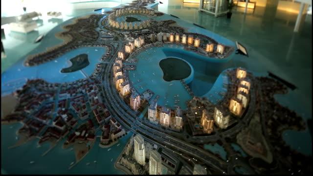 view of architectural maquette showing the design and urban planning of the artificial pearl island, off the coast of qatar. - doha stock videos & royalty-free footage