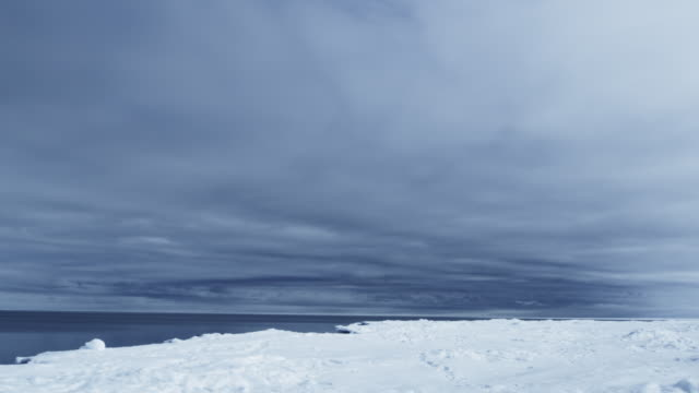 WS T/L View of arctic floe edge ice snow ocean water with storm / Antarctica