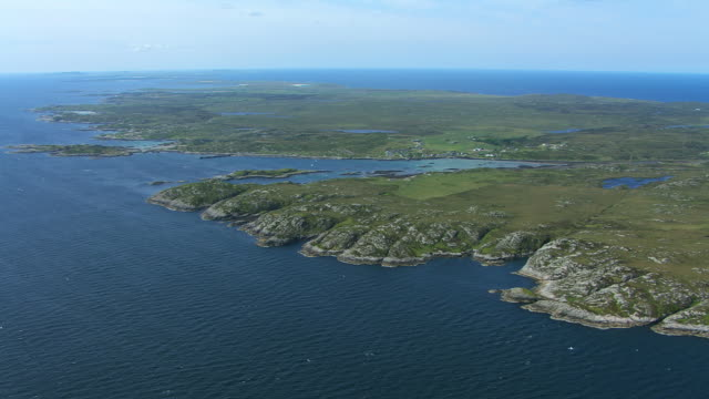 WS AERIAL View of Arinagour village and ferry pier / Isle or island of Coll, Argyll and Bute, Scotland