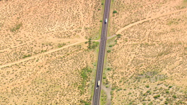 WS AERIAL ZI ZO TS View of Arizona Plains and Containers moving on street / Arizona, United States