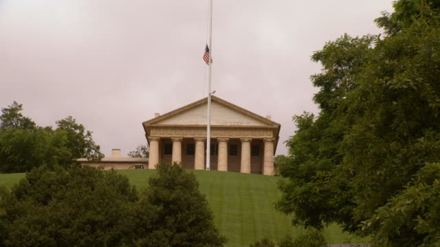 ws view of arlington house at arlington cemetery with american flag flying at half mast / arlington, virginia, united states - arlington national cemetery stock videos and b-roll footage