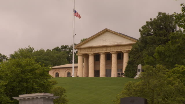 ws view of arlington house at arlington cemetery with american flag flying in front / arlington, virginia, united states - arlington national cemetery stock videos and b-roll footage
