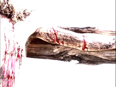 view of arm, chest and side of jesus on cross - cross stock videos & royalty-free footage