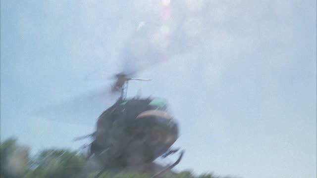 ms view of army helicopter landing in brush area - military helicopter stock videos & royalty-free footage