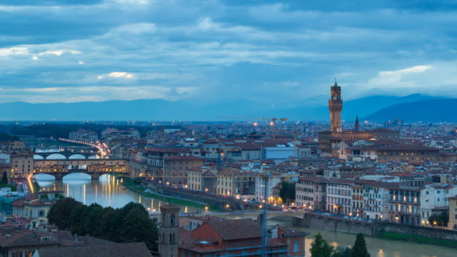 ws t/l pan view of arno river, ponte vecchio with florence cathedral   il duomo di firenze at dusk / florence, tuscany, italy - florence italy stock videos & royalty-free footage