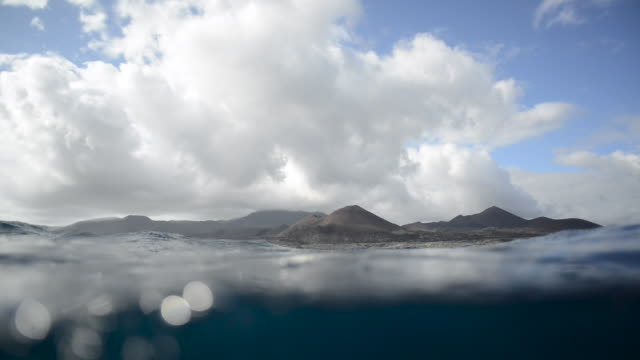 view of ascension island from surface of sea - atlantik stock-videos und b-roll-filmmaterial