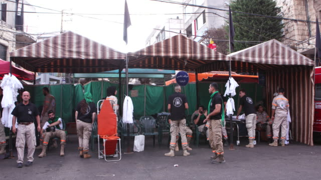 view of ashura volunteers and paramedics waiting under makeshift awnings for the commemorations to start ashura is the 10th day of muharram... - ashura muharram stock videos & royalty-free footage
