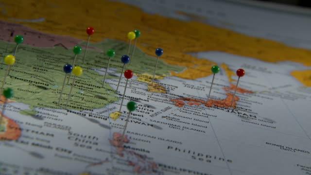 cu pan view of asia in world map with push pins in major cities / atlanta, georgia, usa - 画鋲点の映像素材/bロール