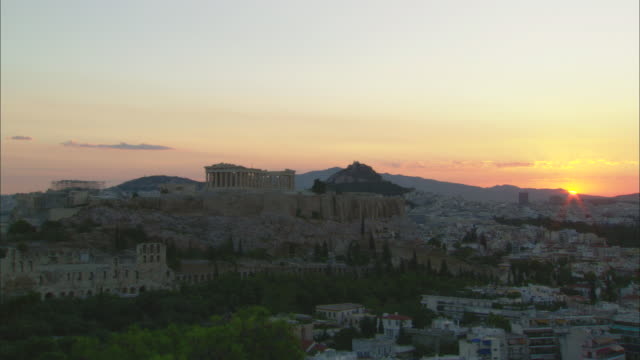 ws view of athens city and acropolis of athens at sunrise / athens, attica, greece  - acropolis athens stock videos & royalty-free footage