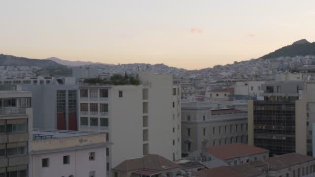 view of athens rooftops before dawn toward mount lycabettus, monastiraki district, athens, greece, europe - lycabettus hill stock videos & royalty-free footage
