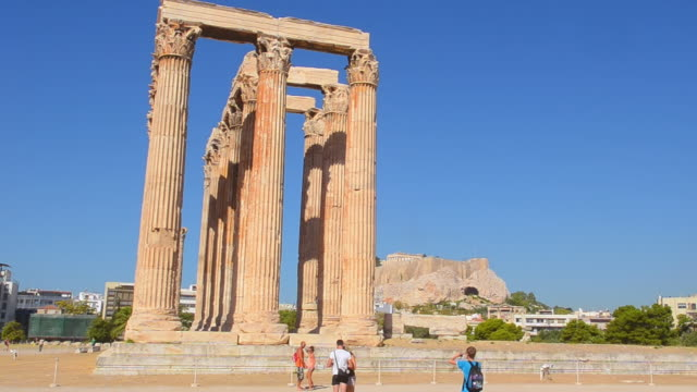 ws view of athens ruins of famous temple of zeus pillars and historical monument landmark with tourist / athens, greece - zeus stock videos and b-roll footage