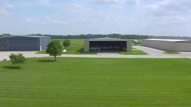 WS AERIAL POV View of Atlantic Municipal Airport with plane / Cass County, Iowa, United States