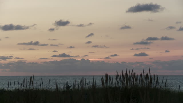 ws view of atlantic ocean in evening / cap de l'homy, aquitaine, france - aquitaine stock videos and b-roll footage