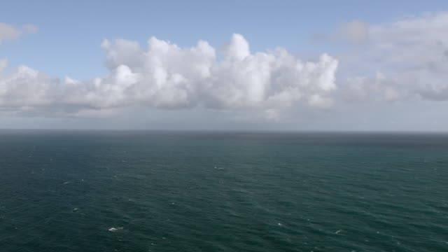 WS PAN AERIAL POV View of Atlantic ocean with scattered clouds / Puerto Rico, United States