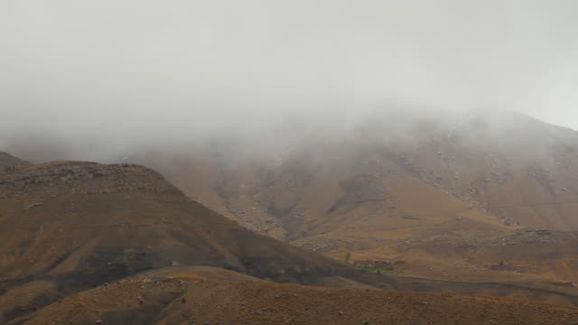 vidéos et rushes de ws view of atlas mountain valley with foggy skies / marrakech, tensift, morocco  - maroc