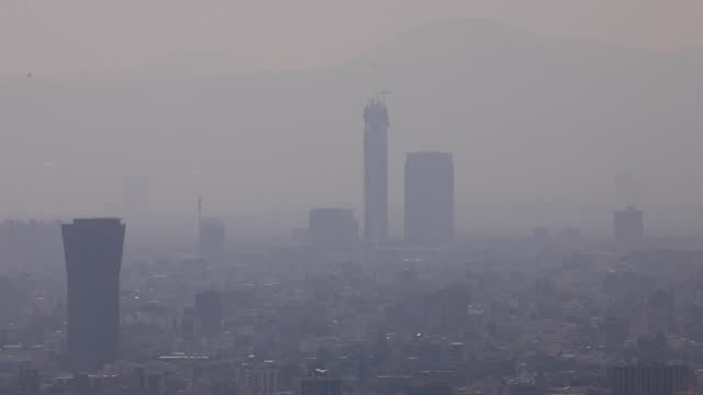"""view of atmospheric pollution ''smog'' over the mexican capital pictured from a rooftop in the """"reforma"""" business district on december 15, 2020 in... - smog stock videos & royalty-free footage"""