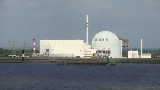 ws view of atomic power plant brokdorf near river elbe, schleswig holstein / hamburg, germany - schleswig holstein stock videos & royalty-free footage
