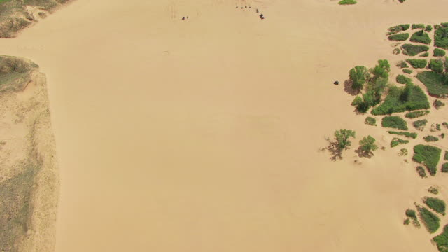 WS AERIAL View of ATVs driving on sand dunes in Little Sahara State Park in Woodward county / Oklahoma, United States