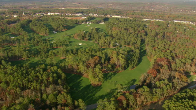 MS AERIAL View of Augusta national golf course with wooded area / Georgia, United States