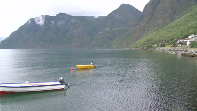 ws pan view of aurlandsfjord with nautical vessel / aurlandsvange, sogn og fjordane, norway - nautical vessel点の映像素材/bロール