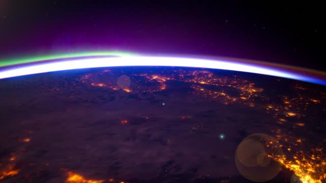 vídeos de stock, filmes e b-roll de iss view of aurora borealis over european lights. subtle flare and motion effect. - east berlin