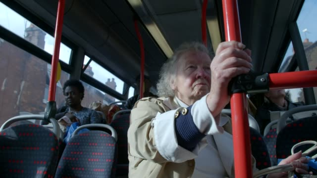 West Midlands Walsall Mel Powell on bus Elderly womn on bus EXT Wide shot Lloyds Bank and people along Man torwards in street Homeless person with...