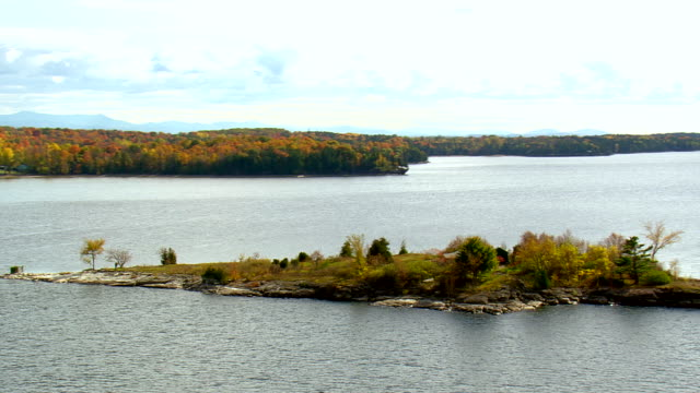 WS AERIAL PAN ZI ZO View of autumn color trees covered trees island in Lake Champlain / Vermont, United States