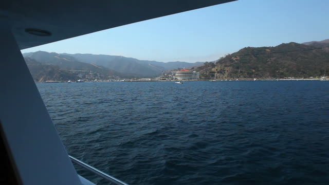 ms pov view of avalon from yacht / catalina island, ca, united states  - channel islands california stock videos & royalty-free footage