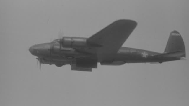 WS ARIEAL View of B17 flying at low altitude with dropping bomb