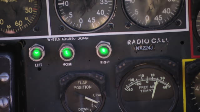 cu view of b-24 bomber cockpit controls with hand-held shake effect / florida, united states - bomber plane stock videos and b-roll footage
