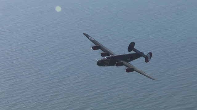 aerial ws ts view of b-24 bomber flypast from above / florida, united states - bomber plane stock videos and b-roll footage
