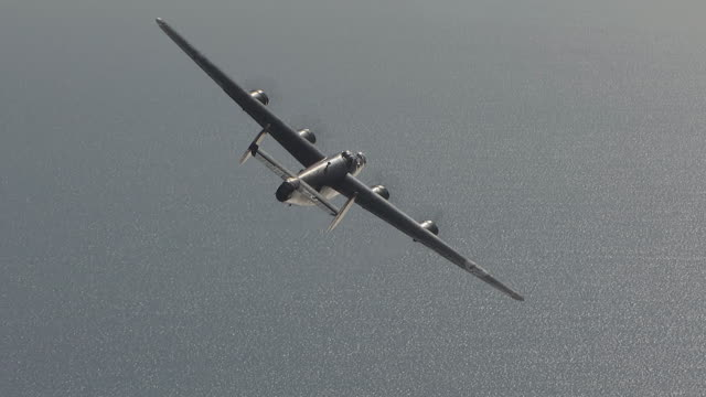 aerial ws zi ts view of b-24 bomber swoop low over sea / florida, united states - bomber plane stock videos and b-roll footage