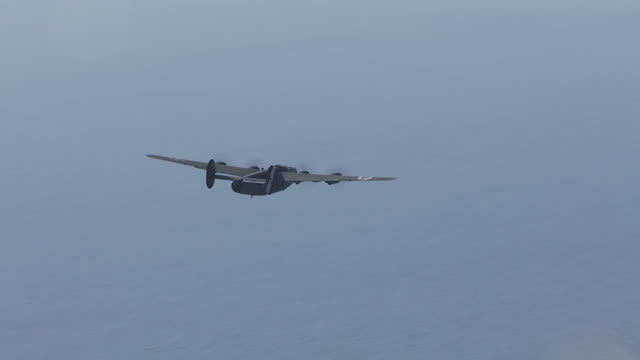 aerial ws ts view of b-24 bomber swoops in over bay / florida, united states - bomber plane stock videos and b-roll footage