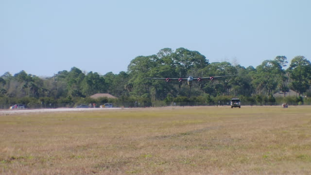 ws ts view of b-24 landing / florida, united states - bomber plane stock videos and b-roll footage