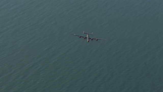 aerial ws ts view of b-24 passes below / florida, united states - bomber plane stock videos and b-roll footage
