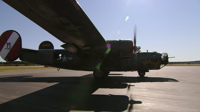 ms pan view of b-24 taxiing on runway / boston, massachusettes, united states - bomber plane stock videos and b-roll footage