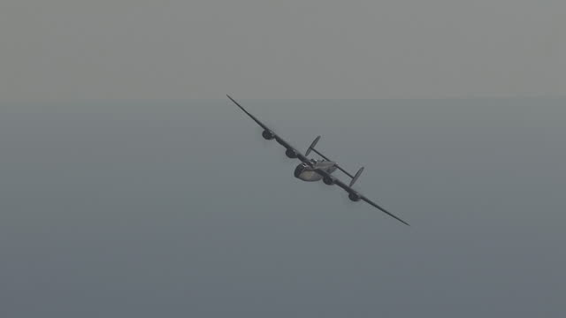 aerial ws ts view of b-24 turning in sky / florida, united states - bomber plane stock videos and b-roll footage