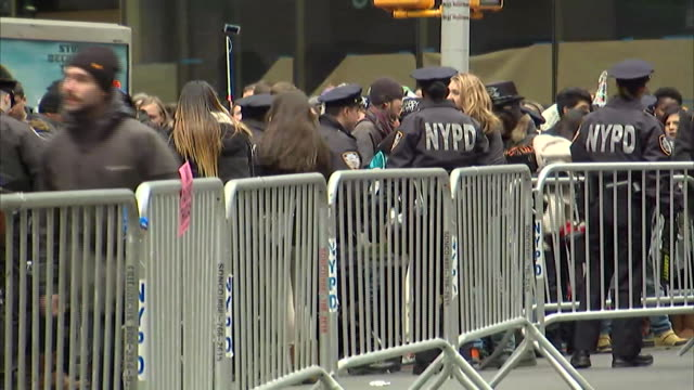 ws view of backs of new york police department officers standing guard in times square before new year's celebration they patrol barricaded area of... - music or celebrities or fashion or film industry or film premiere or youth culture or novelty item or vacations stock-videos und b-roll-filmmaterial