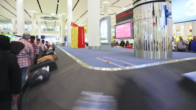 MS T/L View of baggage carousels in arrivals hall  / Dubai,United Arab Emirates