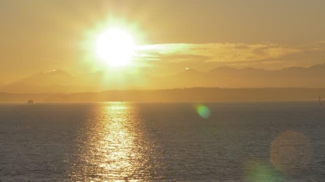 view of bainbridge ferry crossing elliott bay at sunset, seattle, washington state, united states of america, north america - elliott bay bildbanksvideor och videomaterial från bakom kulisserna