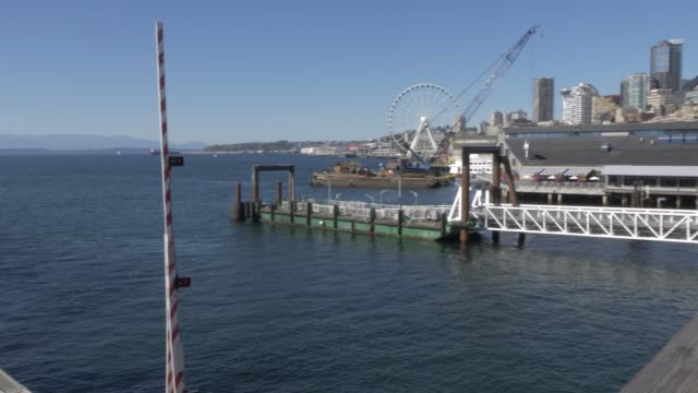 View of Bainbridge-Seattle Ferry unloading at Colman Dock Ferry Terminal and Downtown, Seattle, Washington State, United States of America, North America