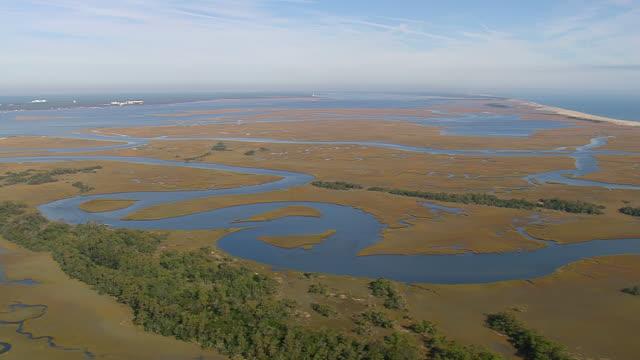 ws aerial view of bald head island / north carolina, united states - bald head island stock videos and b-roll footage