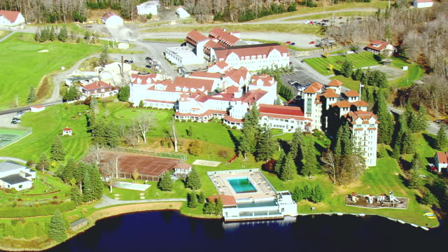 ms aerial ts view of balsams hotel resort at dixville notch village / new hampshire, united states - tourist resort stock videos & royalty-free footage