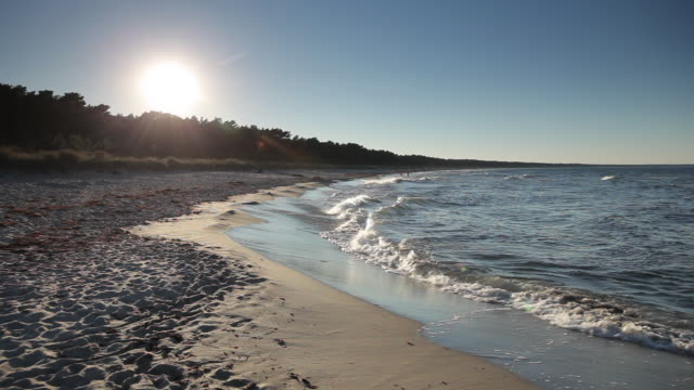 ws view of baltic sea and beach at sunset / island of rugen, mecklenburg vorpommern, germany - baltic sea stock videos and b-roll footage