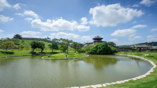 ws t/l view of banghwasuryujeong pavillon with lake in suwon (unesco world heritage site) / suwon, gyeonggi-do, south korea - suwon stock videos and b-roll footage