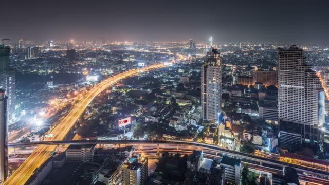 t/l ws ha zo view of bangkok at night / bangkok, thailand - zoom out stock videos & royalty-free footage