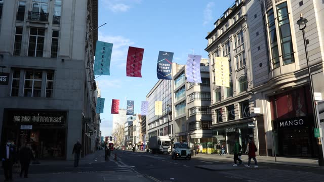 view of banners on oxford street welcoming re-opening businesses and customers on april 11, 2021 in london, england. all non-essential retail will be... - high street stock videos & royalty-free footage