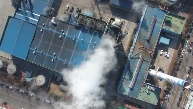 view of banwol industrial complex and chimney smoke in ansan, gyeonggi-do, south korea - fabriksskorsten bildbanksvideor och videomaterial från bakom kulisserna